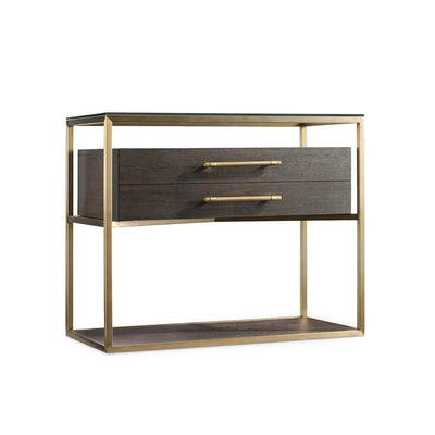 The Leinster Nightstand has a chic modern look and is made of dark wood, a brass frame and glass top.