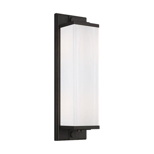 Minimalist wall sconce with a rectangular glass shade and an aged iron finish.