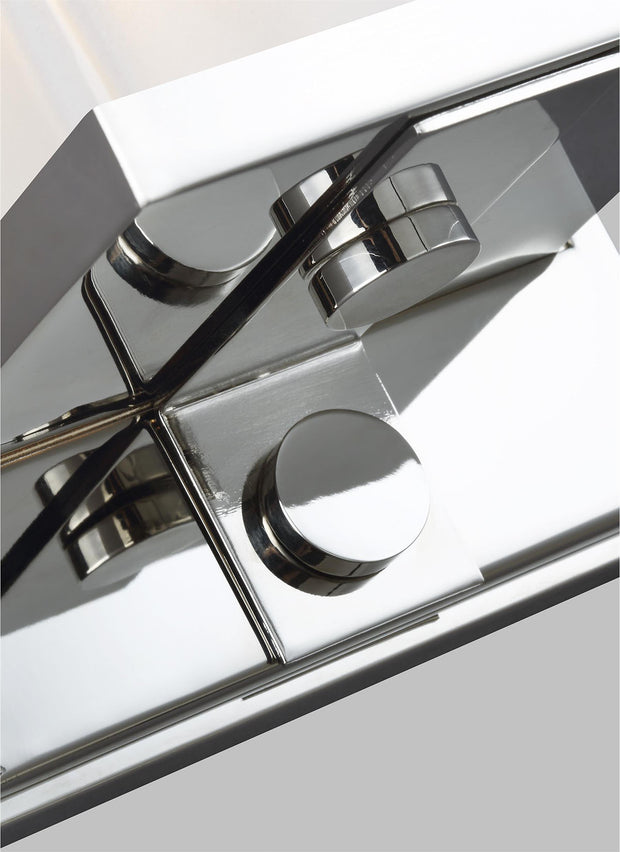Polished nickel details on the minimal wall sconce with a rectangular light.