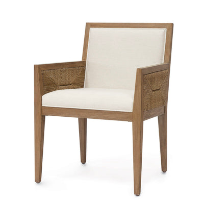 The Loreto Side  Chair boast a costal look with rope detailed sides and an upholstered seat.