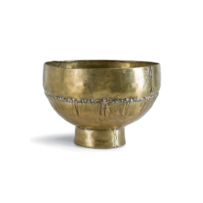 Vintage brass bowl on platform.