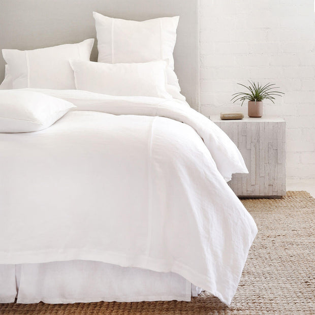 The Springfield Bedding Collection in white made from 100% linen with seamed detail.