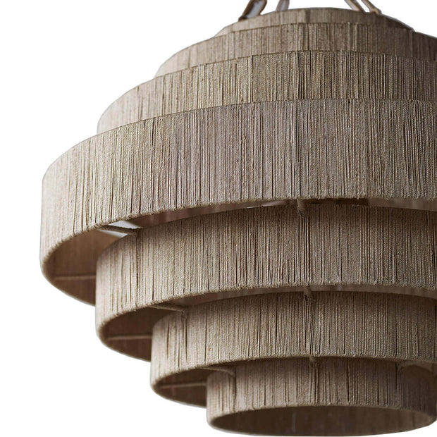 A neutral, tiered statement pendant made from finely woven natural rope.