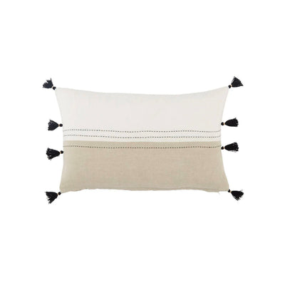 Indoor lumbar pillow with neutral tones and black stitching with black tassels.