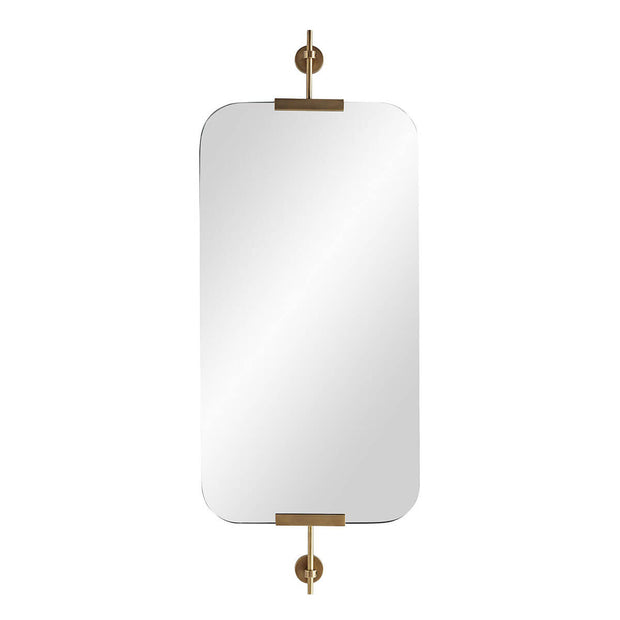 The Cremona Mirror is a rectangular mirror with rounded edges that is held by antique brass brackets for a soft look.