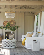 Large beaded chandelier in a outdoor living space.