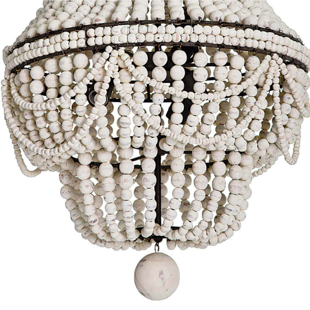 Closeup of the large decorative bead and ropes of white weathered beads on the boho dining room chandelier.