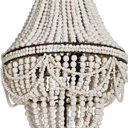 Coastal chandelier with white weather beads and draped details.