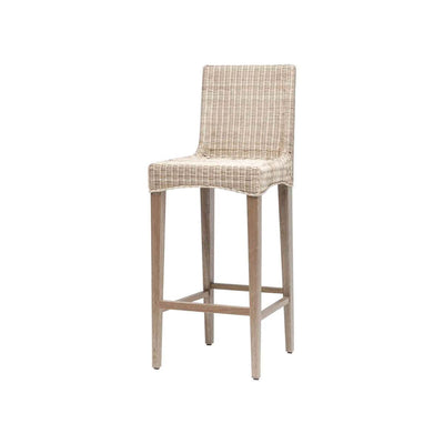 The Mesilla Bar Stool has a solid wood frame and woven wicker seat in a white wash finish.