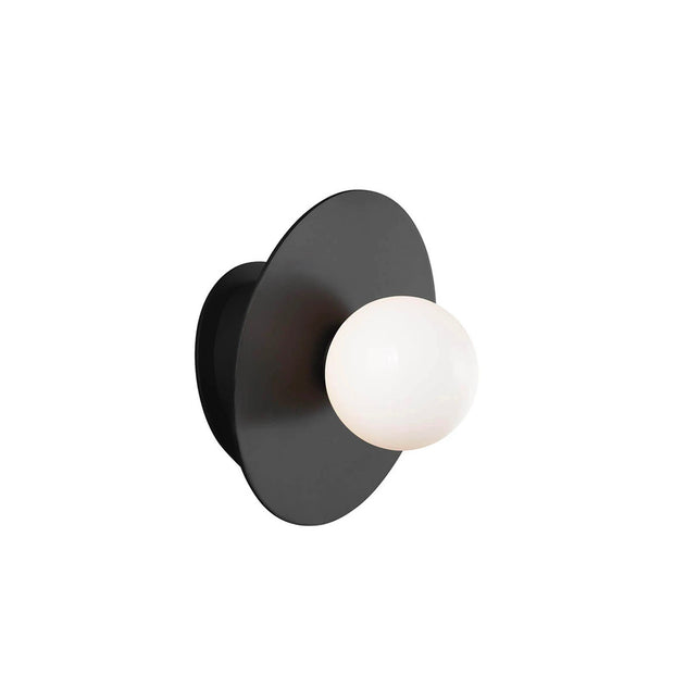 Wall Sconce with a midnight black finish and round glass bulb.