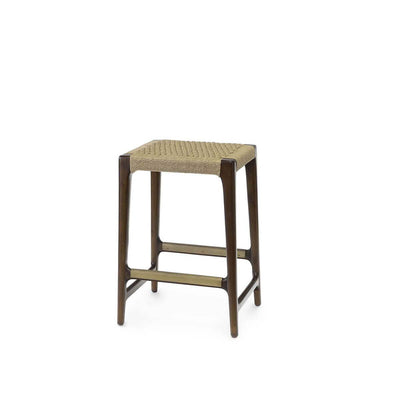 The Bengal  Counter Stool has a dark brown hardwood frame and hand-woven, natural jute rope seat, and brass metal footrest details.