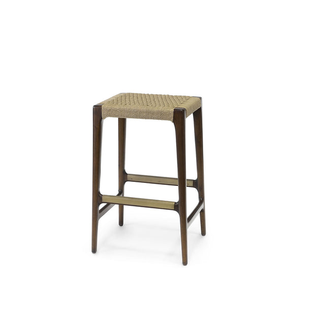 The Bengal  Bar Stool has a dark brown hardwood frame and hand-woven, natural jute rope seat, and brass metal footrest details.