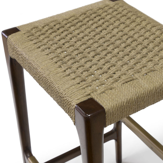 Simple bar stool made from a hardwood frame in a dark finish with a handwoven, natural jute rope seat.