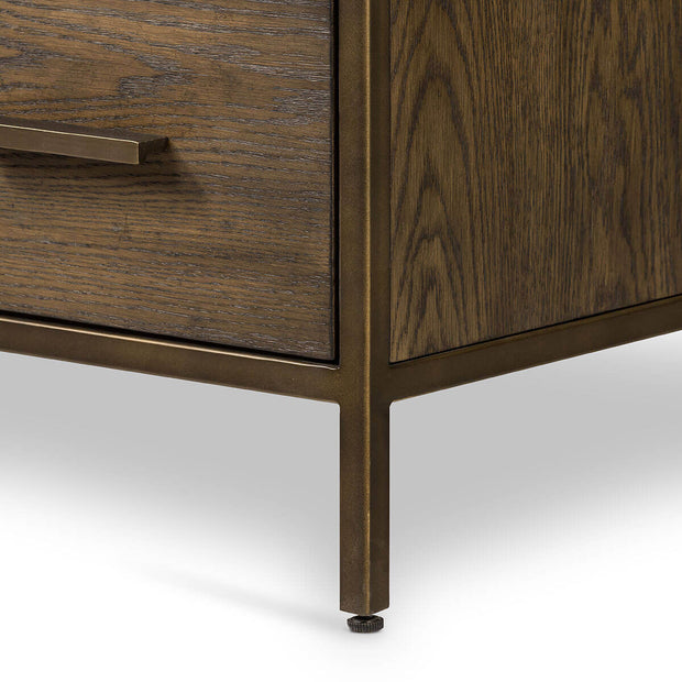 Closeup of the antique brass legs and oak wood drawers on the Vik Dresser.