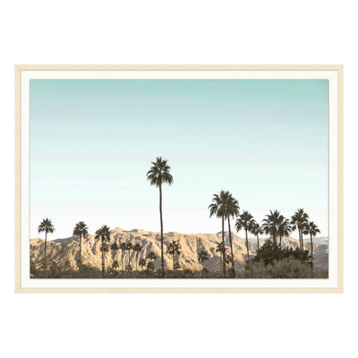A dreamy piece of art that depicts the scenery of Palm Springs through a neutral palette full of beiges, blues, and greens.
