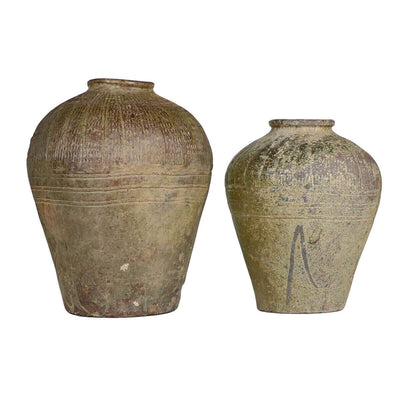 The Suopo Jar is a unique vintage clay jar with aging and marking details.