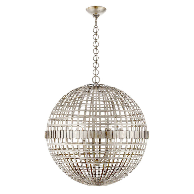 The Mill Globe Lantern is a large burnished silver leaf pendant light with a globe shade and a chain hanger.