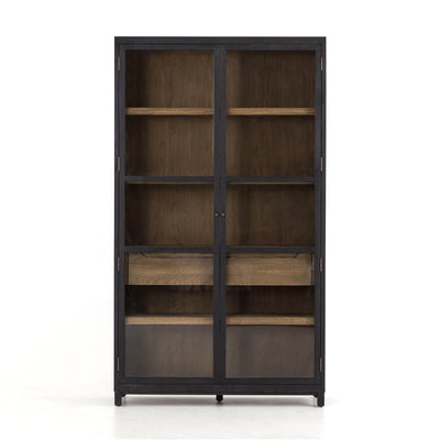 The Frankfurt Cabinet has a black drifted oak frame with lighter interior shelves and drawer and glass doors.