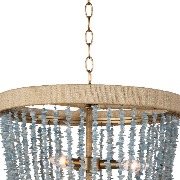 Closeup of the rattan-wrapped metal frame and strings of aqua beads on the sea inspired chandelier.