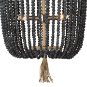 Closeup of the blue black round bead strings and fringe detail on the coastal inspired, beaded chandelier.