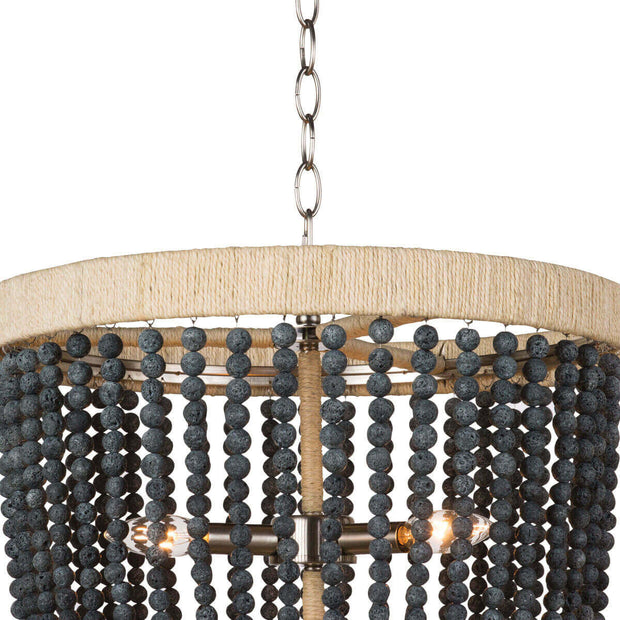 Closeup of the rattan-wrapped, metal frame and dark, round beads on the modern farmhouse chandelier.