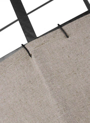 Natural linen shade with overstitching details on a medium dining room pendant.
