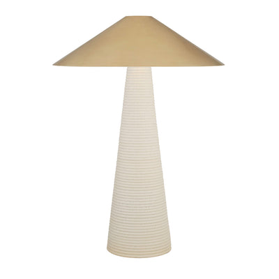 Transitional table lamp with antique brass shade and porous ceramic base.