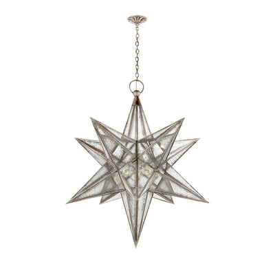 The extra-large Moravian Star Lantern is a star-shaped pendant light with burnished silver leaf joints, antique mirrored panels, and a delicate hanging chain.