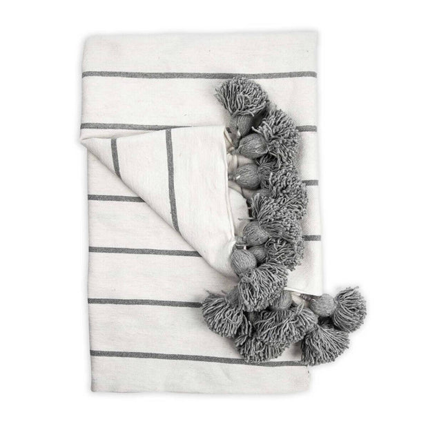 The Casablanca Throw - Light Grey is a white with light grey striped, 100% cotton woven blanket with tassel  trim.