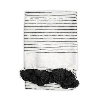 White with grey striped cotton throw blanket with tassel trim.