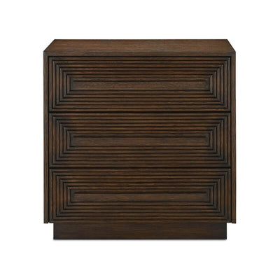 The Burgos Chest is made of oak wood and has geometric carved patterns on the drawer fronts, soft-close gliders, and mahogany dovetail drawer boxes.