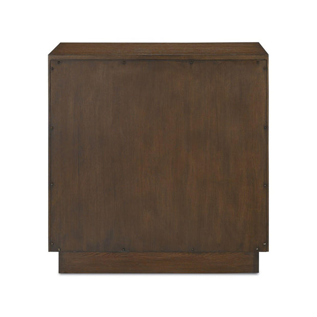 Back view of the dark oak chest with 3 drawers featuring carved geometric designs.