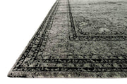 Details and texture of the Aswan Silver Rug. Dark, traditional patterned rug. Hand-knotted rug.