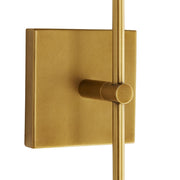 Brass backplate and adjustable arm on a modern living room wall sconce.