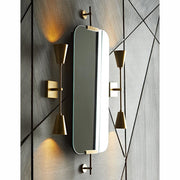 Two modern, symmetrical wall sconces in modern bathroom.