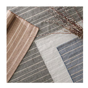 Grey Indoor and Outdoor Rug. Striped grey and white, blue, and black outdoor rugs made out of recycled plastic bottles.