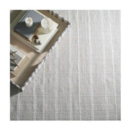 Grey Indoor / Outdoor Rug. Striped grey and white rug made out of recycled plastic bottles, meant for a patio or entrance.