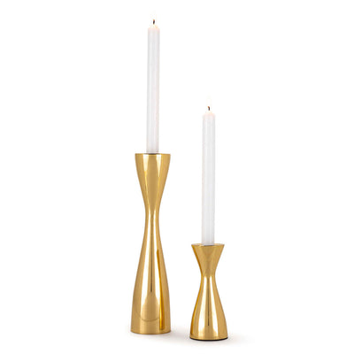 Polished brass candlestick set in a sleek and modern shape.