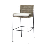 The Belle Fourche Barstool has a black metal frame, natural rattan seat and back, and upholstered, loose seat cushion.