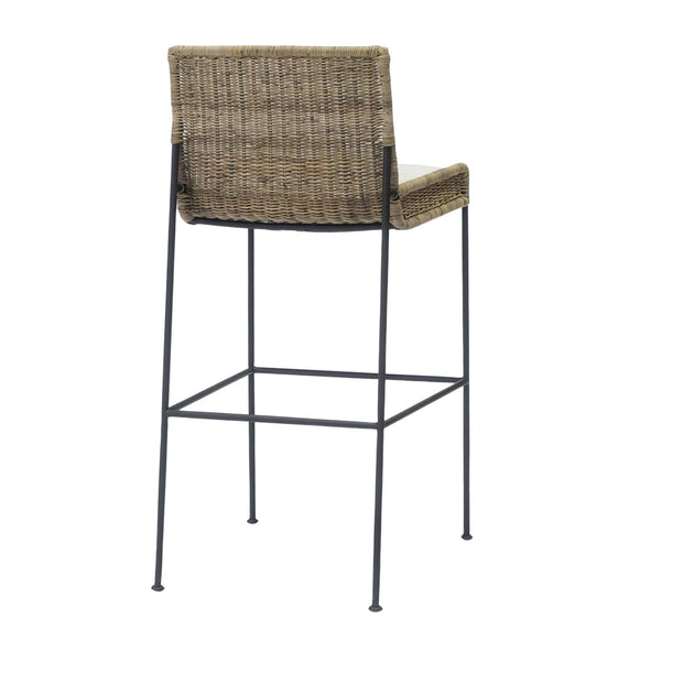 Organic barstool with rattan seat, black metal frame, and loose upholstered seat cushion.