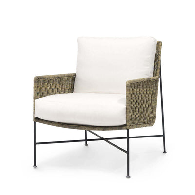 The Honolulu Lounge Chair has a black metal frame and natural rattan peel seat with loose cushions.
