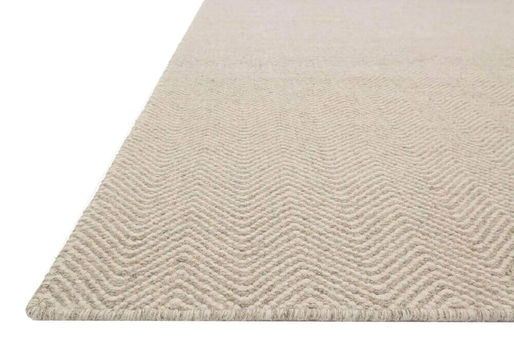 Texture and colour of the Tabuk Gravel Rug. Flat woven, dye-free rug. Light brown rug.