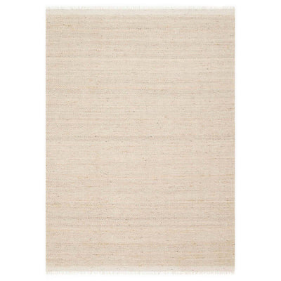 The Lyon Natural Rug is a handwoven jute rug with a subtle, beige chevron pattern.