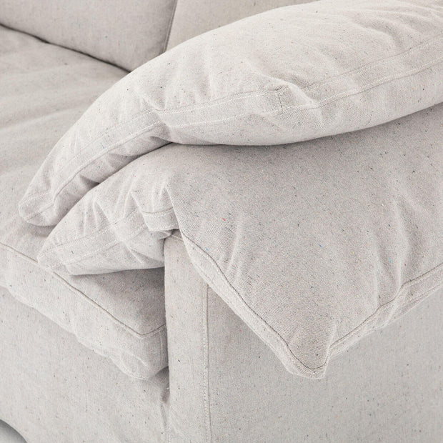 Comfortable and relaxed feeling arm cushions on the classic white sofa.