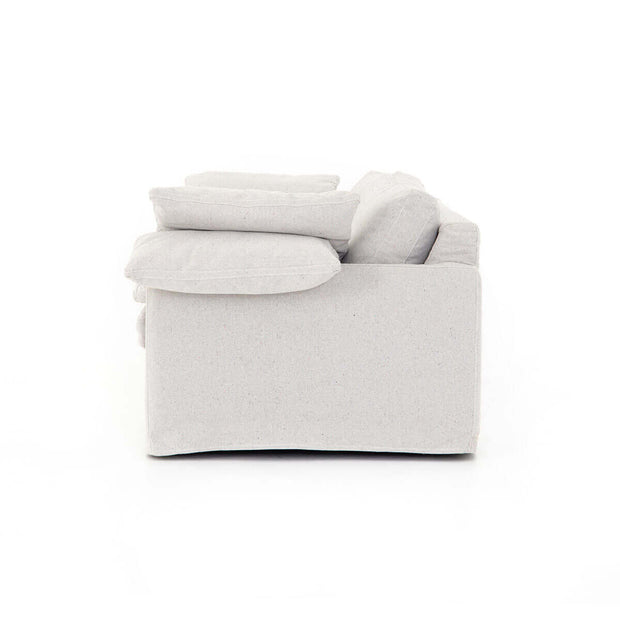 Comfortable back and arm cushions on the classic, white linen sofa.