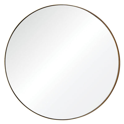 The Obzor Mirror is a large, round mirror with a thin gold frame.