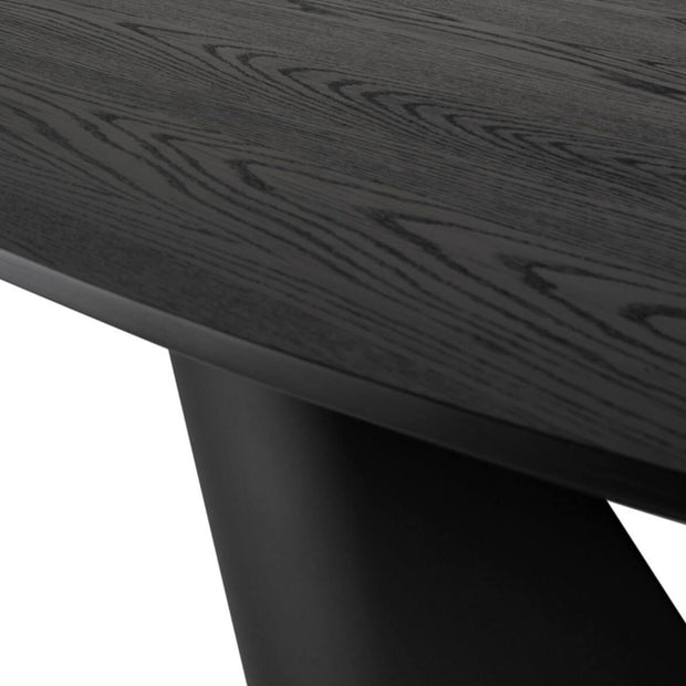 Wood grain and black finish details on the contemporary round dining table.