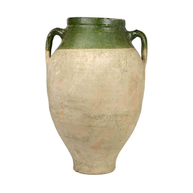 Large clay jar with two handles and with dark green glaze and unique marking details.