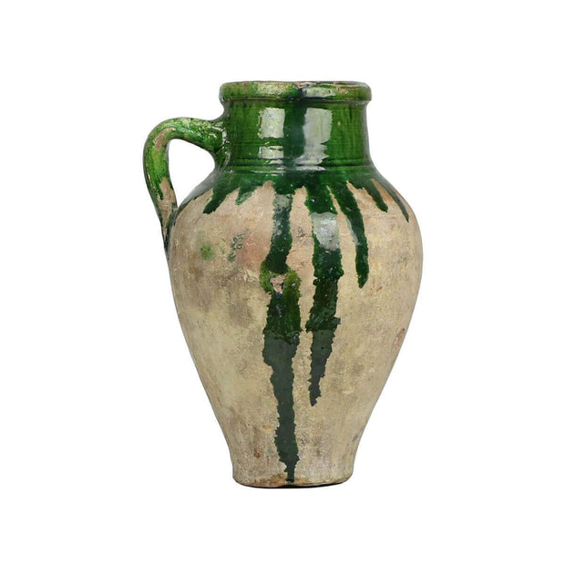 Unique clay jar with green glaze details and unique markings.