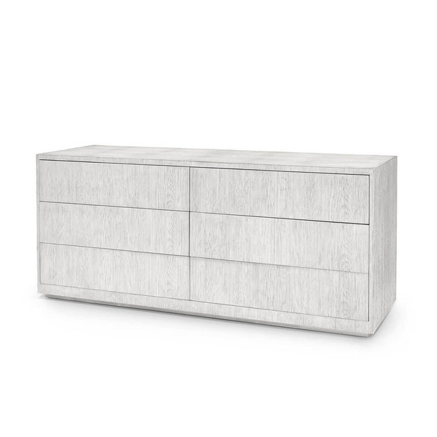 The Goldsboro Dresser has resin fibreglass reeded details on the drawer front and faux shagreen detail on the top with a whitewash finish and six drawers.
